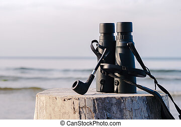 Binocular and tobacco pipe - Black binocular and tobacco ...