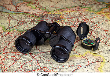 Binoculars and Compass on Old Route Map