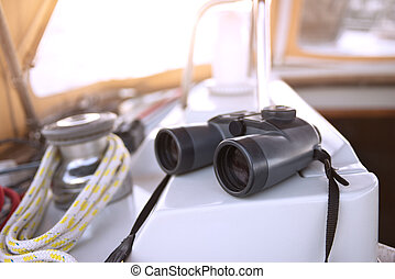 Binoculars and navigational equipment for safe sailing in a sailboat