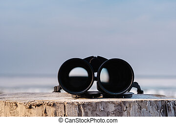 Binoculars at the sea - Binoculars on the stump at the sea