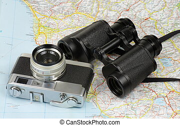 Binoculars, camera and map