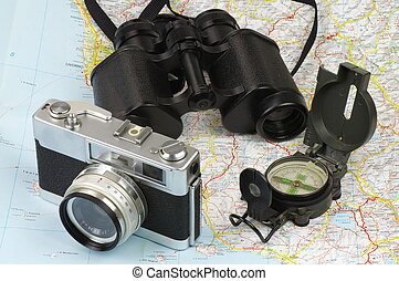 Binoculars, compass, camera and map