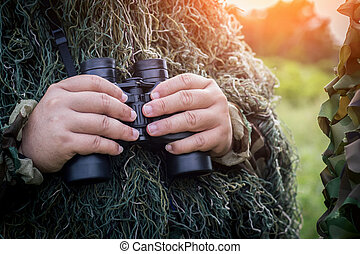 binoculars in the hand of ornithologist