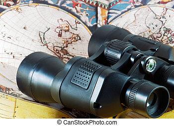 Binoculars on antique map
