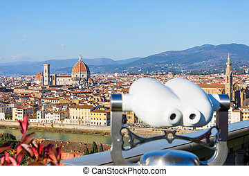 Binoculars on the observation deck in the Piazzale Michelangelo. Florence Italy at sunny day cityscape aerial view.