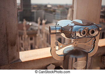 Binoculars on the roof of Duomo in Milan, Italy. Top view to the city, Sunny day