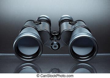 binoculars - close up of binoculars on gray background