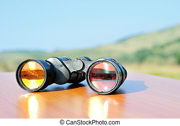 Binoculars on table in nature