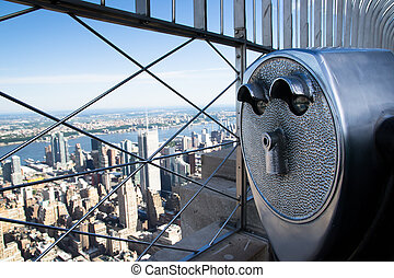 binoculars to observe the city
