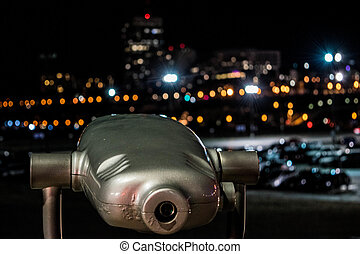 binoculars With city in background