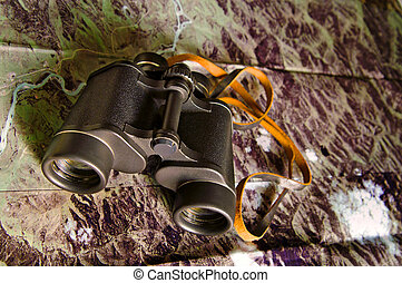 binoculars with map