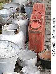 bins and metal buckets used to transport the milk