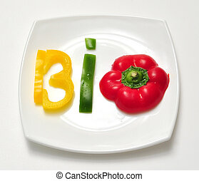 bio food vegetable slice text on white plate