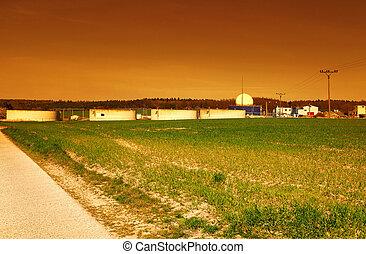 Bio gas plant at sunset