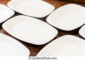 Biodegradable dish on wooden background. - Biodegradable ...