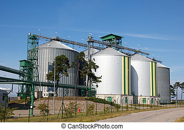 Biofuel tanks - Multiple white biofuel tanks with green and...