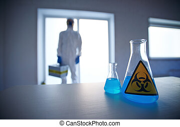 Biohazard liquid - Close-up of two flasks with blue...
