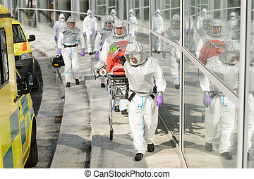 Biohazard medical team walking to building