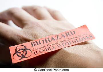 Biohazard - Photo of hand with a biohazard sticker on it.