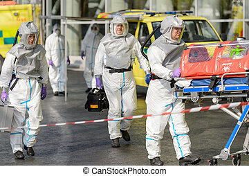 Biohazard team with stretcher walking on street - Biohazard...