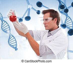 Biologist examining a beaker of blood