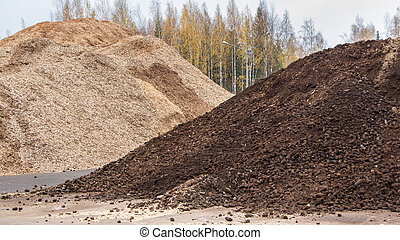 Biomass peat and woodchips at an industrial site