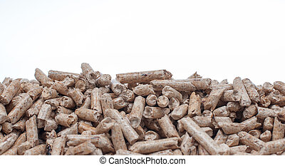 Biomass- pine pellets on a white background
