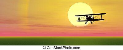 Biplan by sunset - Old biplan flyinig upon grassland by...