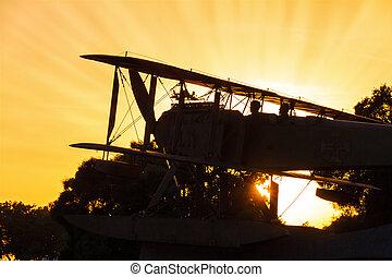 biplan, coucher soleil