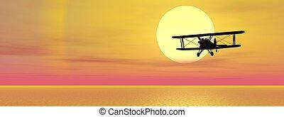 Biplan upon ocean - Old biplan flying upon ocean by sunset