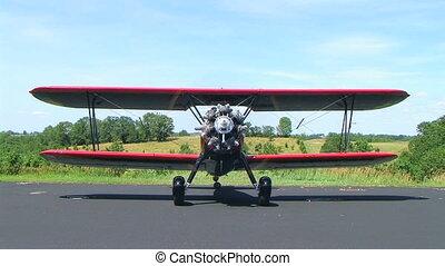 Biplane - Boeing Stearman biplane setting idlle.