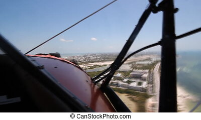 Shot from front cockpit of antique 1940 UPF-7 Waco biplane approaching runway. Timelapse. Key West, Florida.