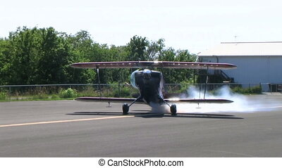 Biplane Spinning with Smoke - Christen Eagle II biplane...