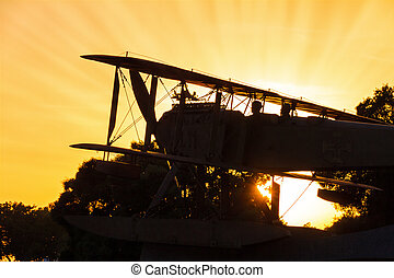 Biplane sunset - Beautiful silhouette of a biplane monument...