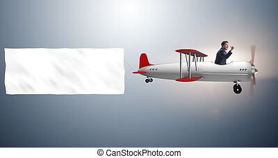 Biplane with businessman and blank banner