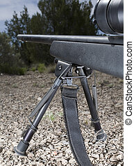 Bipod - Rifle on a ridgeline that is stabilized on a bipod