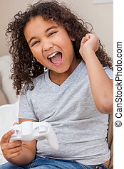 Biracial African American Girl Female Child Playing Video Games
