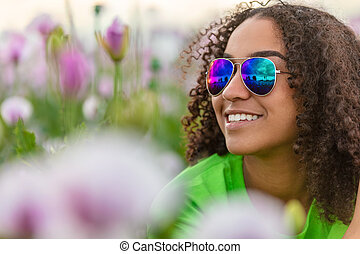 Biracial Young Woman Girl Teenager in Field of Flowers Wearing Sunglasses