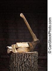 birch firewood, old rusty ax