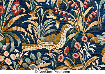 Detail of a Medieval tapestry showing a bird in garden