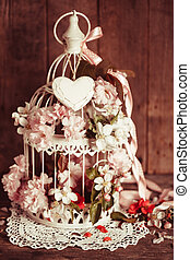 Bird cage with wooden heart