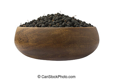 Bird cherry dried in a wooden Cup on a white background. Isolated object
