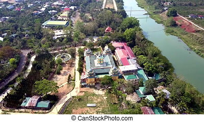 bird eye flight Buddhist complex on river bank - bird-eye...