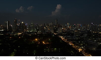 Bird eye time lapse view of night big city panorama of Bangkok, Thailand