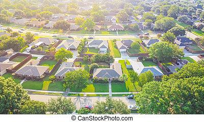 Bird eye view clean and peaceful neighborhood streets with row of single family homes near Dallas, Texas, USA
