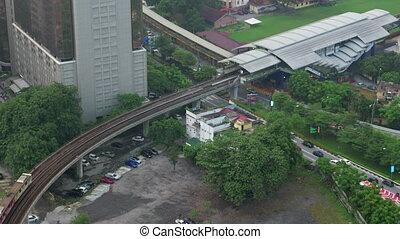 Bird eye view of railways across road against city landscape. Kuala Lumpur, Malaysia