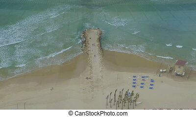Bird eye view of the beach and sea with rocky pier - Aerial...