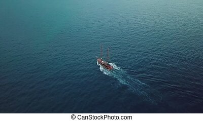 Bird eye view on a boat at open sea in the middle of nowhere. Sailing in the wind through the waves in the ocean. Beautiful ocean landscape. Rippling texture. Gran Canaria.