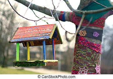 Bird feeder hanging on a tree