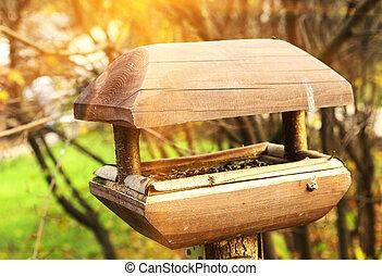 bird feeder manger wooden close up photo